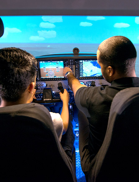 Students learning in flight simulator