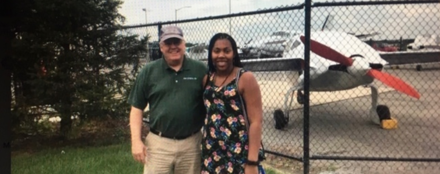 Angela Wright and her father next to a plane