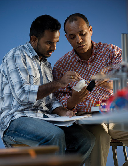 Two students working on an engineering project