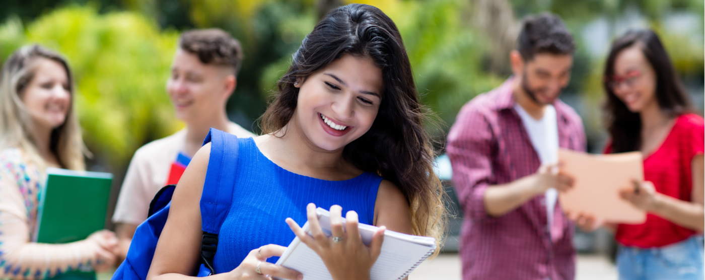 Female Mexican student receiving good news about college scholarship
