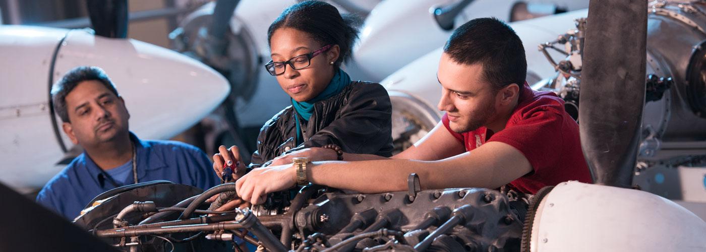 Students performing aviation maintenance