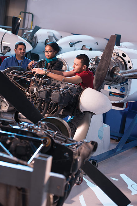 Students working on engine