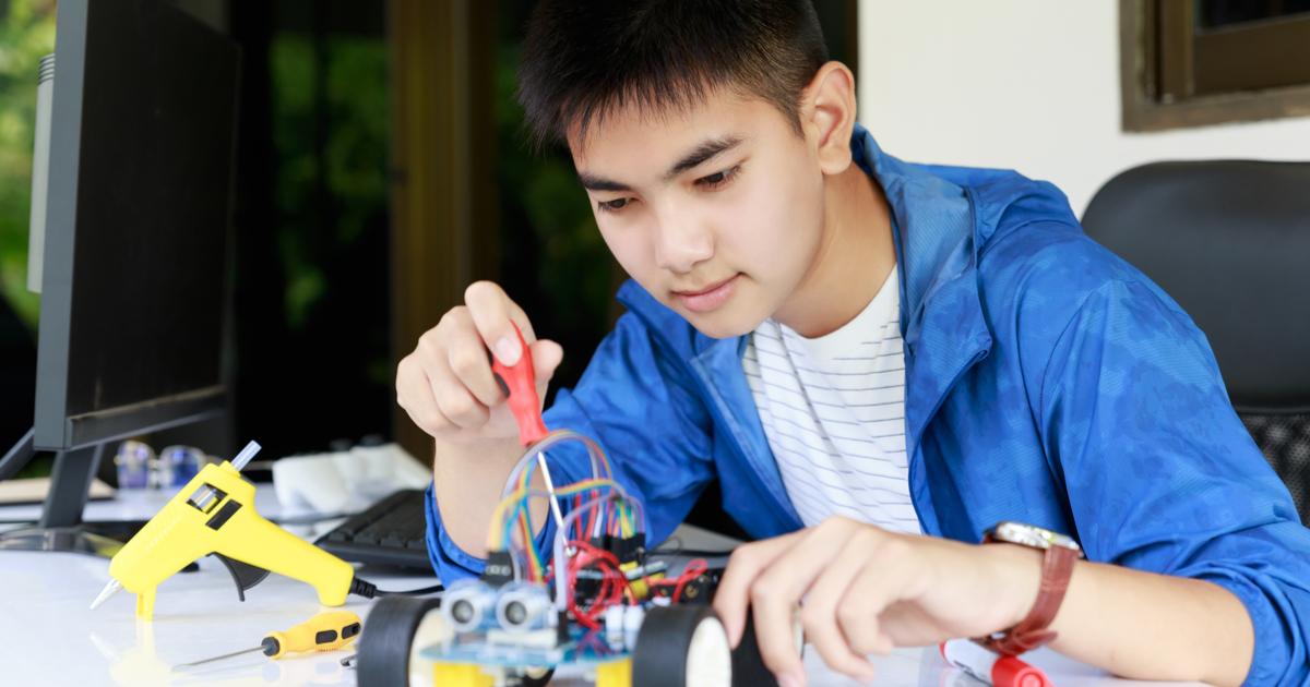 STEM student making a model car