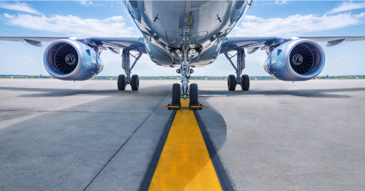 The underbelly of a plane on a runway